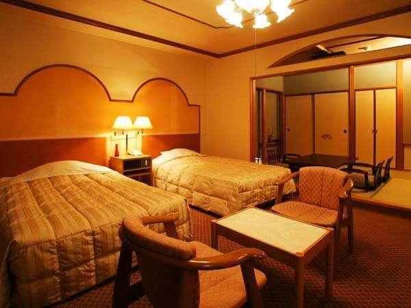 和洋室 ツインベッド付きのゆったり広めです。