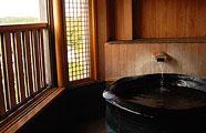 写真:最上階温泉付き客室
