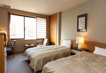 写真:コンパクトなツインベッド洋室