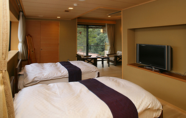 写真:新ひのき展望露天風呂付客室(ベッドルームタイプ)