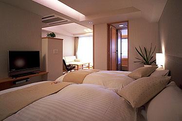 写真:かけ流し温泉露天風呂付客室