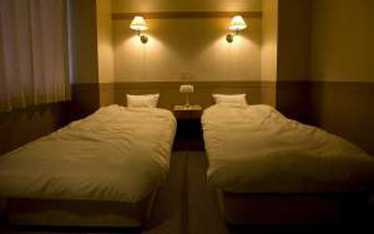 写真:ベッドルーム付和室