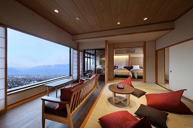 写真:温泉露天風呂付和洋室