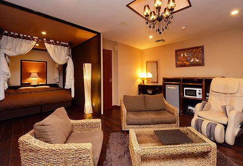 写真:セミスイート天蓋付キングダブルベッドルーム